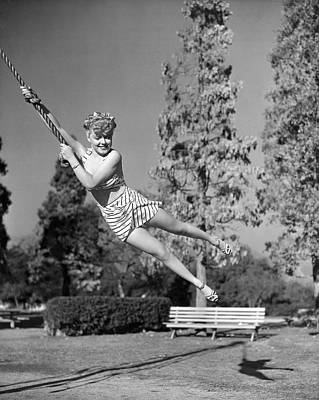 Two Piece Photograph - Woman Swinging On A Rope by Underwood Archives
