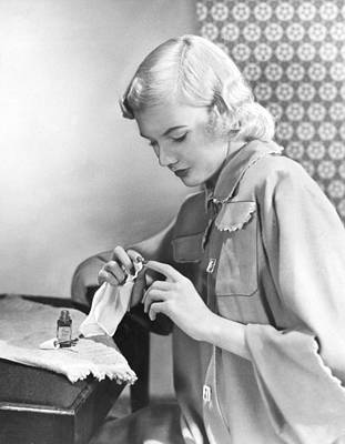 Woman Taking Care Of Her Nails Print by Underwood Archives