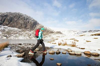 Gear Photograph - Woman Walker And Frozen Stickle Tarn by Ashley Cooper