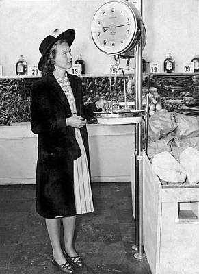 Food Stores Photograph - Woman Weighing Vegetables by Underwood Archives