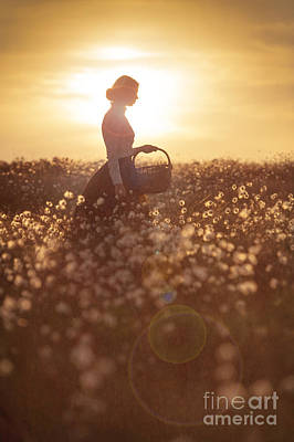 Woman With A Wicker Basket At Sunset Print by Lee Avison