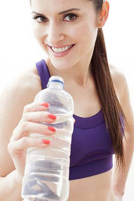 Woman With Water Bottle Print by Ian Hooton
