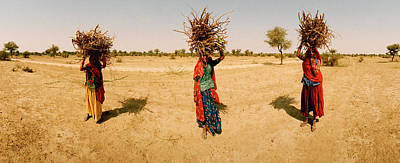 Women Carrying Firewood On Their Heads Print by Panoramic Images