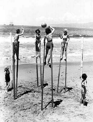 Volleyball Photograph - Women On Stilts by Retro Images Archive