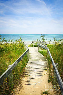 Wooden Walkway Over Dunes At Beach Print by Elena Elisseeva