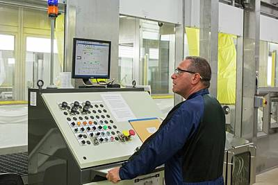 Sterling Photograph - Worker At Car Assembly Line Control Panel by Jim West