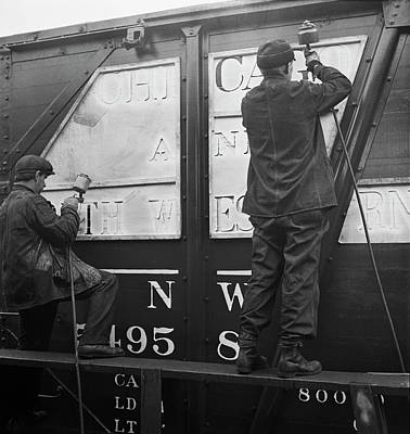 Workers Stenciling The Name Print by Stocktrek Images