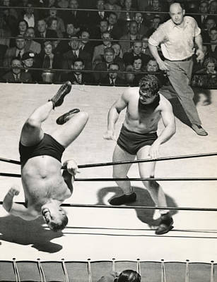 Wrestler Thrown Out Of Ring Print by Underwood Archives