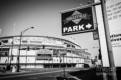 Wrigley Field And Wrigleyville Signs In Black And White Print by Paul Velgos
