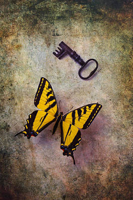 Yellow Butterfly With Key Print by Garry Gay