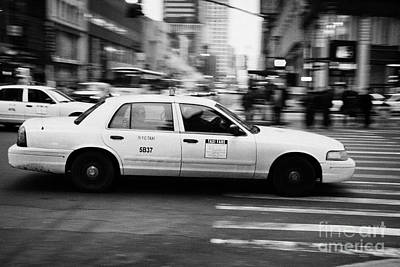 Yellow Cab Blurring Past Crosswalk And Pedestrians New York City Usa Print by Joe Fox