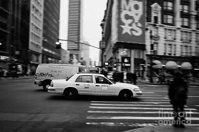 yellow cab taxi blurs past pedestrian waiting at crosswalk on Broadway outside macys new york usa Print by Joe Fox