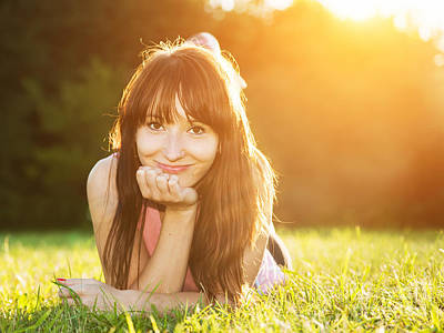 Portrait Photograph - Young Beautiful Natural Woman Lying On The Grass At Summer Sunset by Michal Bednarek