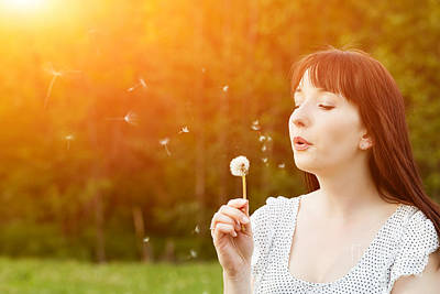 Female Photograph - Young Beautiful Woman Blowing A Dandelion In Spring Scenery by Michal Bednarek