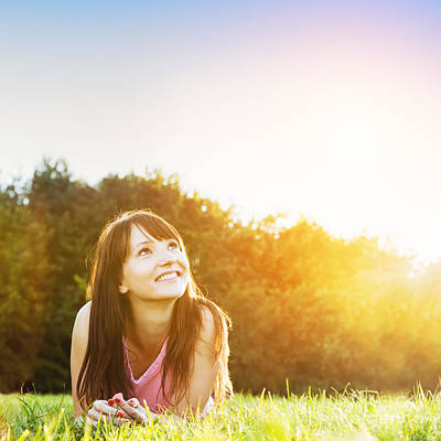 Women Photograph - Young Beautiful Woman Smiling And Lying On The Grass At Summer Sunset by Michal Bednarek