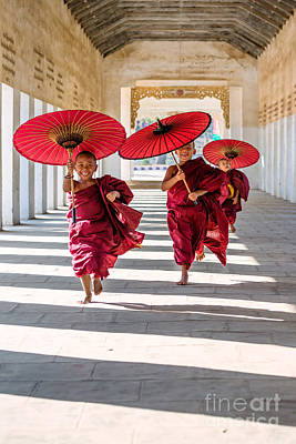 Young Buddhist Monks On The Run - Myanmar Print by Matteo Colombo