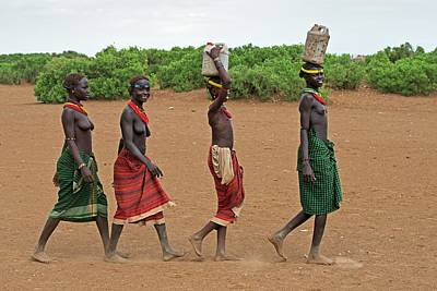African People Photograph - Young Dassenech Girls Carrying Water by Tony Camacho