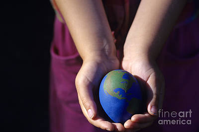 Self Discovery Photograph - Young Girl Holding Earth Egg by Jim Corwin