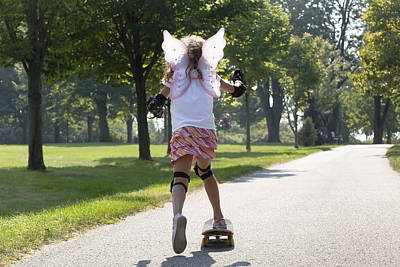 Young Girl Skateboarding While Wearing Print by Mary Ellen McQuay