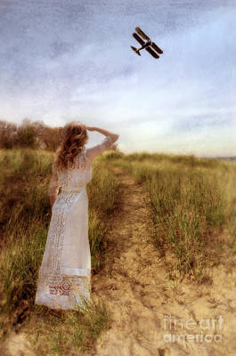 Young Lady In Vintage Clothing Watching A Biplane Print by Jill Battaglia