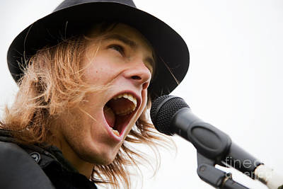 Noise Photograph - Young Man Sings To Microphone by Michal Bednarek
