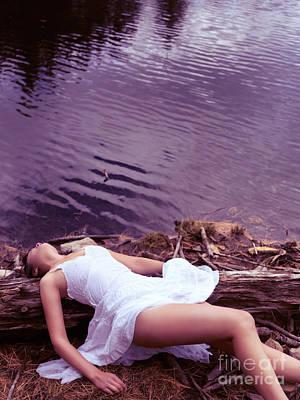 Young Woman In White Dress Lying Near Lake Print by Oleksiy Maksymenko