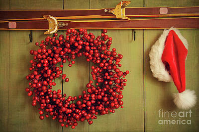 December Photograph -  Red Wreath With Santa Hat Hanging On Rustic Wall by Sandra Cunningham
