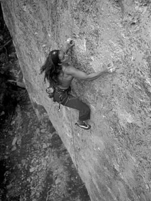 A Caucasian Women Rock Climbing Print by Bobby Model