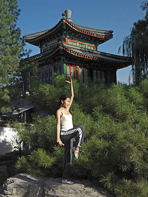 Balance In Life Photograph - A Chinese Woman In Her 20s To 30s Doing by Justin Guariglia