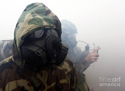 -wars And Warfare- Photograph - A Marine Wearing A Gas Mask by Stocktrek Images