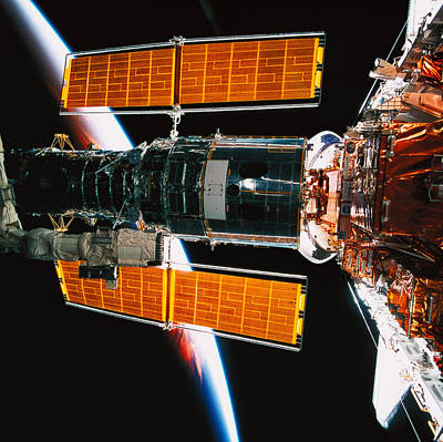 Space Ships Photograph - A Satellite Docked On The Space Shuttle by Stockbyte