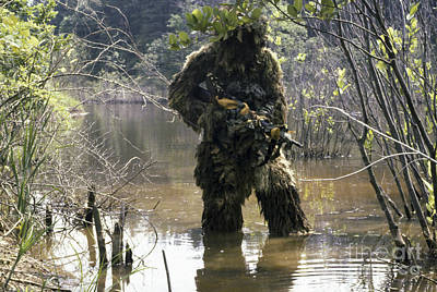 A Sniper Dressed In A Ghillie Suit Print by Stocktrek Images