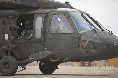 Cob Speicher Photograph - A Uh-60 Black Hawk Taxis by Terry Moore
