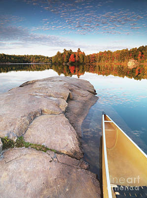 Canoe At A Rocky Shore Autumn Nature Scenery Print by Oleksiy Maksymenko