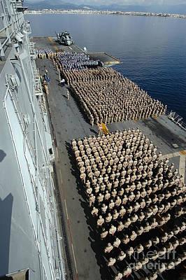 Crew Aboard The Amphibious Assault Ship Print by Stocktrek Images