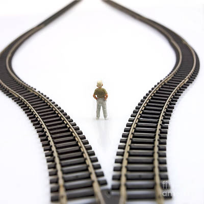 Future Photograph - Figurine Between Two Tracks Leading Into Different Directions  Symbolic Image For Making Decisions. by Bernard Jaubert