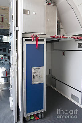 Airline Industry Photograph - Food Compartment On An Airplane by Jaak Nilson