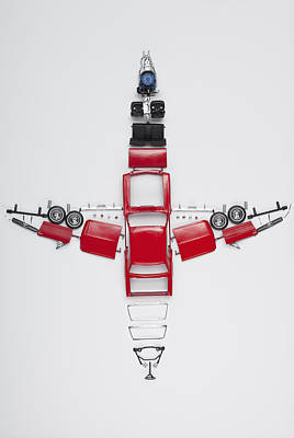Parts Of A Model Car Arranged In The Form Of An Airplane Print by Larry Washburn