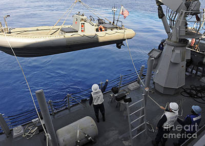 Inflatable Photograph - Sailors Lower A Rigid Hull Inflatable by Stocktrek Images
