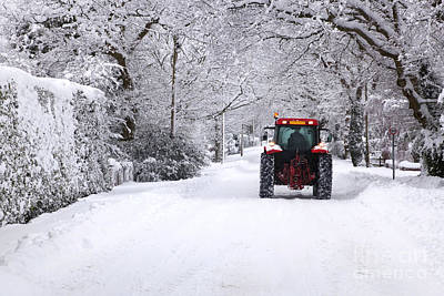 Tractor Driving Down A Snow Covered Road Print by Richard Thomas