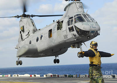 Japan Relief Photograph - A Ch-46e Sea Knight Helicopter Takes by Stocktrek Images