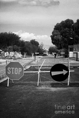greek cypriot army memorial sign at the UN buffer zone in the green line dividing cyprus Print by Joe Fox