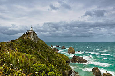 Nugget Point Light House And Dark Clouds In The Sky Print by Ulrich Schade