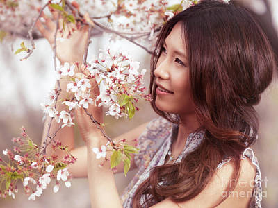 Portrait Of A Young Smiling Woman Standing At A Cherry Tree Print by Oleksiy Maksymenko