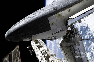 Space Shuttle Discovery Docked Print by Stocktrek Images