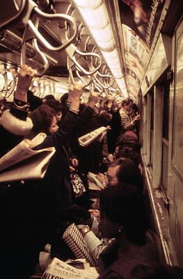 1970s America. Passengers On A Subway Print by Everett