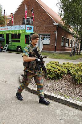 A Belgian Soldier On Patrol Print by Luc De Jaeger