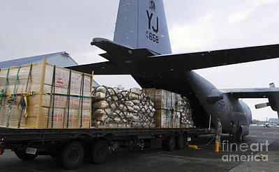 Japan Relief Photograph - A C-130 Hercules Prepares To Transport by Stocktrek Images