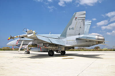 A Canadian Air Force Fa-18 Hornet Armed Print by Giovanni Colla