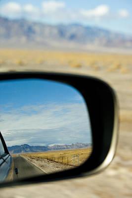A Car Driving Through The Desert Print by Rob Casey